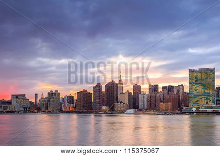 New York City With Skyscrapers Illuminated Over Hudson River