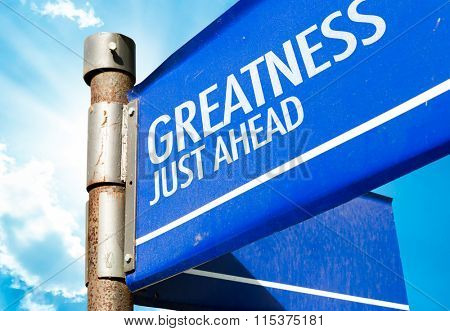 Greatness Just Aehad written on road sign