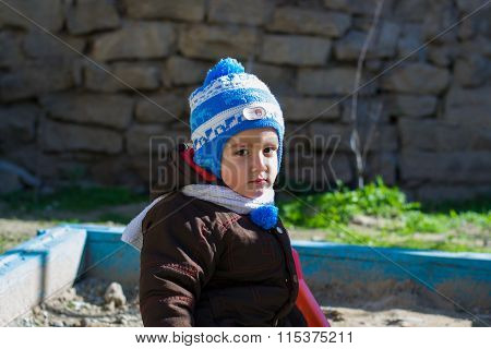 Boy Playing In The Sandbox