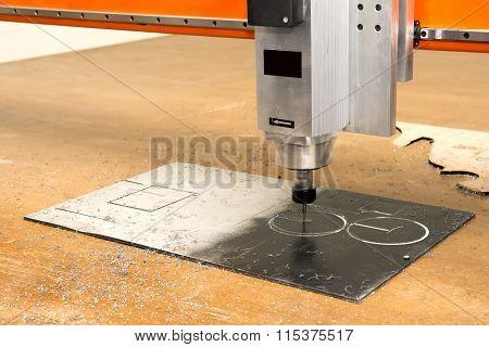 Computer Aided Cutting Machine At Work