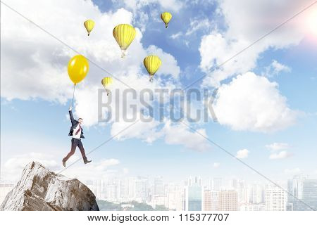 Man Flying On A Balloon