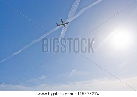 Plane In Foggy Sky With Contrails