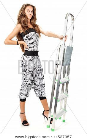 Young Woman In Harem Pants Posing With Step-ladder On White