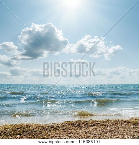 stormy sea and cloudy sky with sun