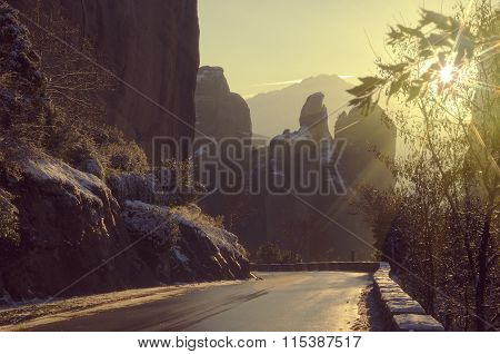 Sunset In The Meteora Mountains. Road To The Meteora Monasteries In Winter.  Vintage Color Tone Land