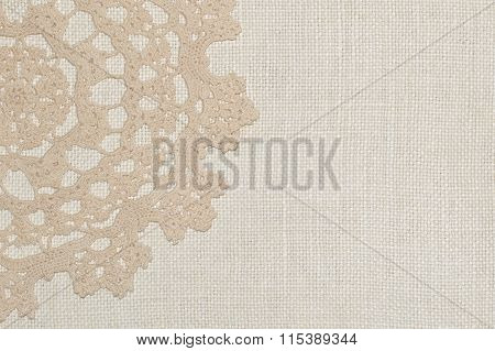 Crochet lace on linen background