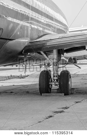 Black And White Close-up Of An Open Landing Gear. Detailed Black And White View Of A Wing With A Dep