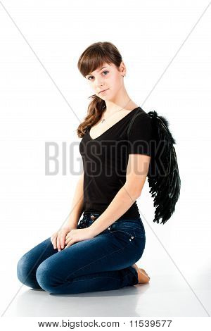 Beautiful Girl Sitting In Black Wings
