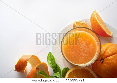 Squeezed Orange Juice In A Glass On Plate Top View