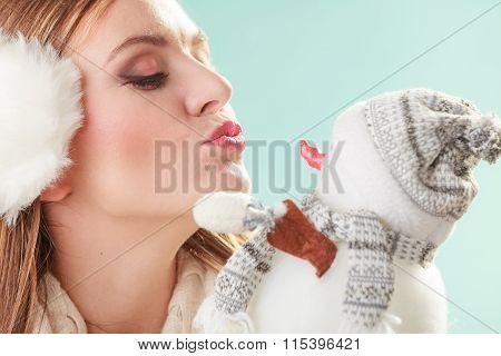 Cute Woman Kissing Little Snowman. Winter Fashion.