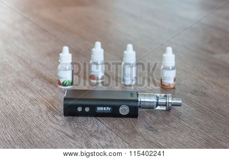 Electronic Cigarette With Liquids Close Up