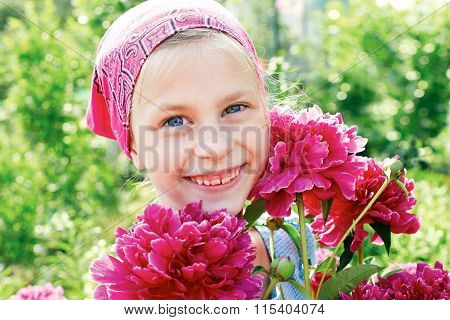 Little Girl With A Bouquet Of Pink Peonies