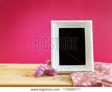 White Vintage Photo Frame With Sweet Statice Flower With On Red Pink Background And Wooden Table , R