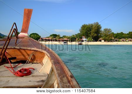 Thai Traditional Wooden Boat Head To The Beach On Island