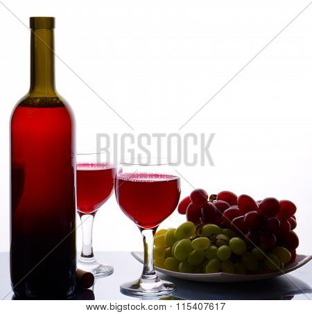 Bottle Of Sweet Red Wine And Grapes