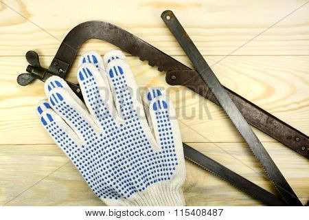 Hacksaw And Gloves