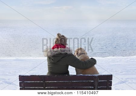Woman with dog on bench