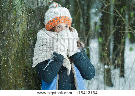 Portrait Of Girl Hiding Her Face With Wooly Knitted Bulky Scarf During Winter Frost Snowfall Outdoor