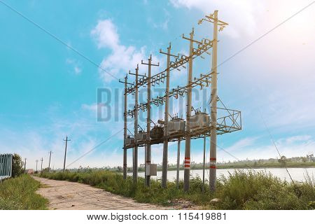 Rural Dirt Road Next To The Power Transformer