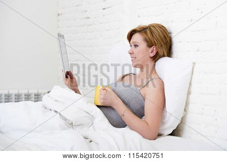 Attractive Woman On Bed Using Digital Tablet Pad Reading Morning Online News In Internet Having Coff