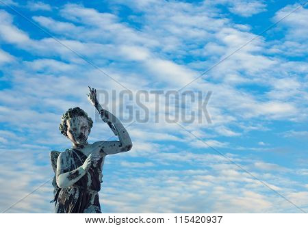 statue with wings and torch