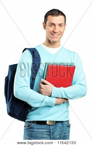 A Male Student With A School Bag Holding Books