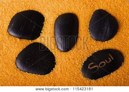 Several Lava Stones In Yellow Sand