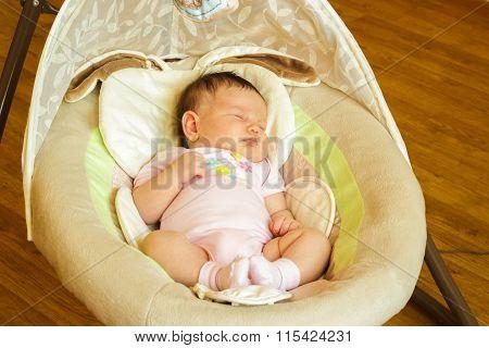 Baby girl newborn sleeping in the cradle