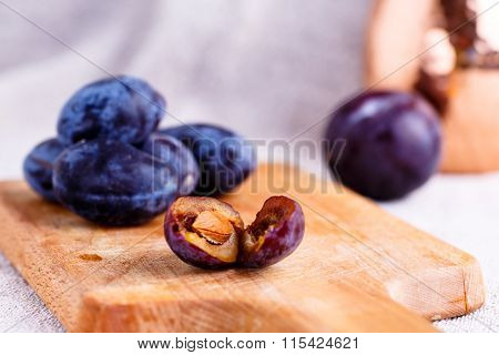 Plum Stone Is Laying On The Board.