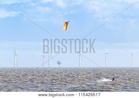 Surfing past a offshore wind farm