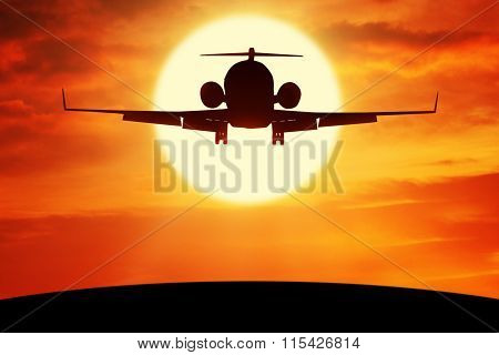 Airplane Flies Over The Hill At Dusk Time