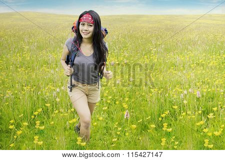 Attractive Model With Rucksack On Meadow