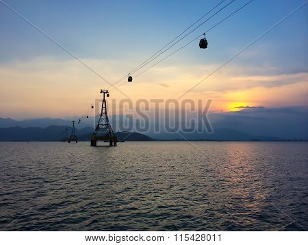 Cable car with cloudy sky on the background at sunset
