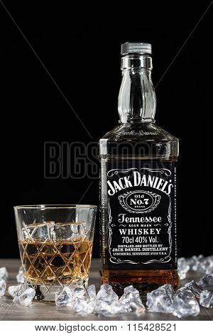 TELFORD, UK - JANUARY 22, 2016: A bottle of Jack Daniel's Tennessee Whiskey on black.  The Jack Daniel's brand of owned by the Brown-Forman Corporation and operates from Moore County, Tennessee, USA