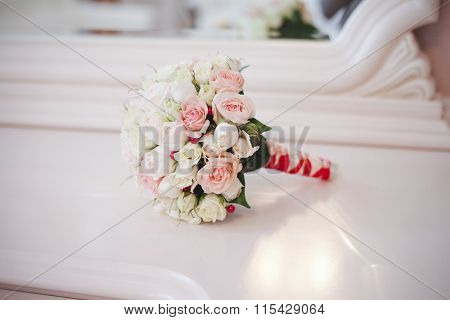 Wedding Bouquet Of Roses On The Table