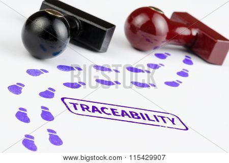 Close Up Shot Of Traceability Stamp With Footprints Path.