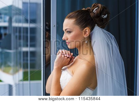 Bride are looking through the window.