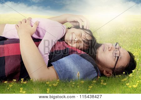 Man Caress His Daughter On Meadow