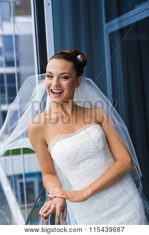 Bride near the glass wall.