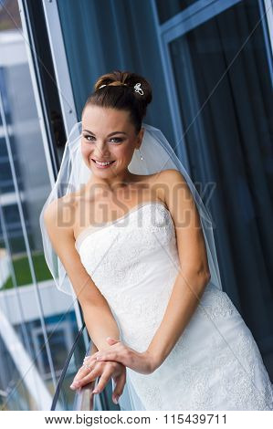 Fabulous bride near the window.