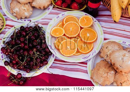 Oranges Petioles And Strawberries Laid Out On Plates On The Table
