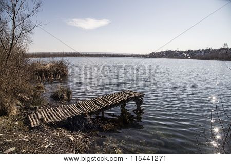 Pontoon on the lake in a sunny day