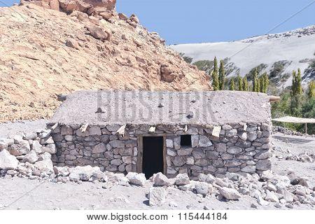 Deserted old stone house in Atacama desert