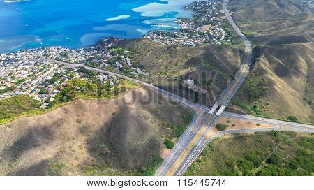 aerial view of highway in hawii from helicopter.