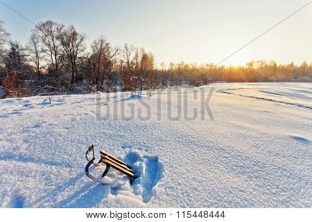 winter landscape with sledge and sun rays