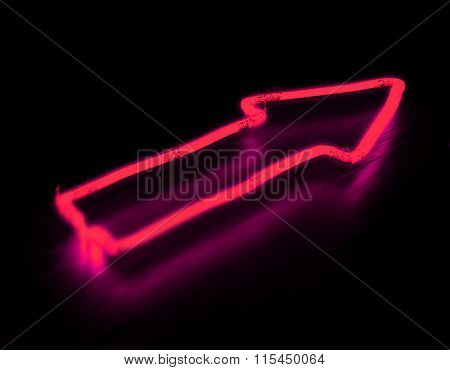 Arrow neon sign isolated on black background