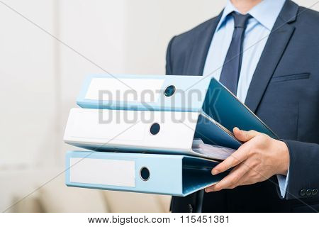 Professional office worker holding folders