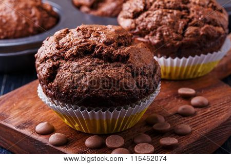 Chocolate Muffins With Chocolate Drops On Dark Background.