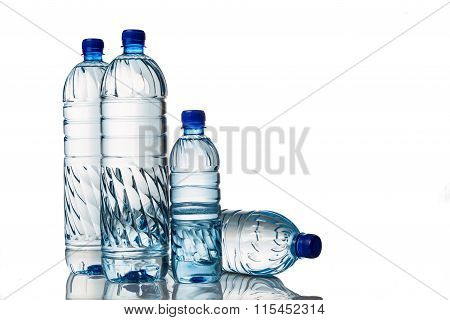 Four Refreshing Mineral Water In Plastic Bottle In White Background