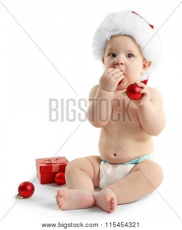 Cute baby with Santa Claus hat and Christmas decorations isolated on white background